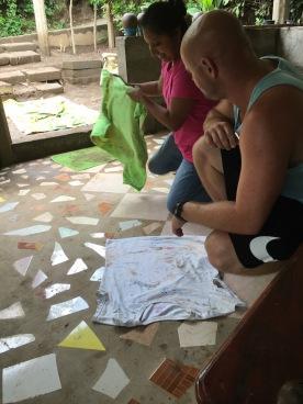 Rian teaching lady in Nicaragua t-shirt fold trick