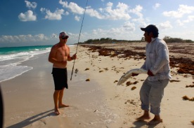 Rian giving local his barracuda catch